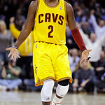 Cleveland Cavaliers' Kyrie Irving celebrates after making a 3-pointer against the Los Angeles Lakers in the second quarter of an NBA basketball game, Tuesday, Dec. 11, 2012, in Cleveland. (A …