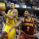 Indiana Pacers' George Hill (3) is fouled by Cleveland Cavaliers' Kyrie Irving (2) as he goes up for a shot during the second half of an NBA basketball game on Wednesday, Dec. 12, 2012, in I …