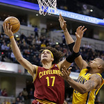 Cleveland Cavaliers' Anderson Varejao (17) puts up a shot against Indiana Pacers' David West during the first half of an NBA basketball game on Wednesday, Dec. 12, 2012, in Indianapolis. (AP …