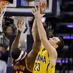 Indiana Pacers' Ben Hansbrough (23) and Cleveland Cavaliers' Tristan Thompson (13) battle for a rebound during the second half of an NBA basketball game on Wednesday, Dec. 12, 2012, in India …