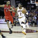 Cleveland Cavaliers' Kyrie Irving (2) drives on Toronto Raptors' Alan Anderson (6) in an NBA basketball game Tuesday, Dec. 18, 2012, in Cleveland. (AP Photo/Mark Duncan)