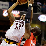 Cleveland Cavaliers' Alonzo Gee (33) shoots over Toronto Raptors' Mickael Pietrus (20), of France, in the second quarter of an NBA basketball game, Tuesday, Dec. 18, 2012, in Cleveland. (AP  …
