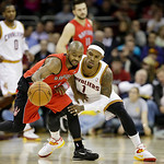 Cleveland Cavaliers' Daniel Gibson (1) defends Toronto Raptors' John Lucas in an NBA basketball game Tuesday, Dec. 18, 2012, in Cleveland. (AP Photo/Mark Duncan)