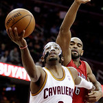 Cleveland Cavaliers' Kyrie Irving (2) shoots inside Toronto Raptors' John Lucas in the fourth quarter of an NBA basketball game, Tuesday, Dec. 18, 2012, in Cleveland. Irving scored 23 points …