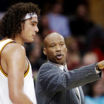 Cleveland Cavaliers head coach Byron Scott, right, instructs Anderson Varejao, of Brazil, in the first half of an NBA basketball game against the Toronto Raptors, Tuesday, Dec. 18, 2012, in  …