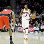 Cleveland Cavaliers' Kyrie Irving (2) brings the ball up against Toronto Raptors' Alan Anderson in an NBA basketball game Tuesday, Dec. 18, 2012, in Cleveland. (AP Photo/Mark Duncan)