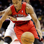 Toronto Raptors' DeMar DeRozan, front, is fouled by Cleveland Cavaliers' Kyrie Irving in the third quarter of an NBA basketball game, Tuesday, Dec. 18, 2012, in Cleveland. Toronto won 113-99 …