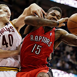 Cleveland Cavaliers' Tyler Zeller (40) battles Toronto Raptors' Amir Johnson (15) for a rebound in the first quarter of an NBA basketball game, Tuesday, Dec. 18, 2012, in Cleveland. (AP Phot …