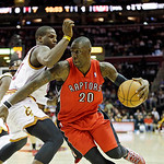 Toronto Raptors' Mickael Pietrus (20), from France, drives on Cleveland Cavaliers' Dion Waiters in an NBA basketball game Tuesday, Dec. 18, 2012, in Cleveland. (AP Photo/Mark Duncan)