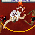 Toronto Raptors' DeMar DeRozan (10) grabs a rebound against Cleveland Cavaliers' Tyler Zeller and teammate Amir Johnson (15) in an NBA basketball game Tuesday, Dec. 18, 2012, in Cleveland. ( …