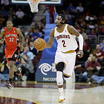 Cleveland Cavaliers' Kyrie Irving (2) brings the ball up against the Toronto Raptors in an NBA basketball game Tuesday, Dec. 18, 2012, in Cleveland. (AP Photo/Mark Duncan)
