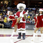 Mascot Moondog performs with the Cavalier Girls during an NBA basketball game between the Toronto Raptors and Cleveland Cavaliers Tuesday, Dec. 18, 2012, in Cleveland. (AP Photo/Mark Duncan)