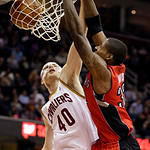Toronto Raptors' Ed Davis dunks on Cleveland Cavaliers' Tyler Zeller (40) in the third quarter of an NBA basketball game, Tuesday, Dec. 18, 2012, in Cleveland. The Raptors won 113-99. (AP Ph …