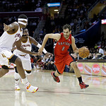 Toronto Raptors' Jose Calderon (8), from Spain, drives on Cleveland Cavaliers' Kyrie Irving, center, and Tristan Thompson in an NBA basketball game Tuesday, Dec. 18, 2012, in Cleveland. (AP …