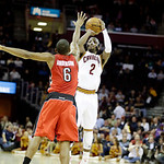 Cleveland Cavaliers' Kyrie Irving (2) shoots over Toronto Raptors' Alan Anderson in an NBA basketball game Tuesday, Dec. 18, 2012, in Cleveland. (AP Photo/Mark Duncan)
