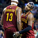 Cleveland Cavaliers guard Kyrie Irving (2) reacts with forward Tristan Thompson (13) after Thompson missed two free throws in the fourth quarter of an NBA basketball game against the Boston …