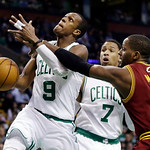 Cleveland Cavaliers forward C.J. Miles (0) reaches in and fouls Boston Celtics guard Rajon Rondo (9) as he drives to the basket while forward Jared Sullinger (7) watches during the first qua …