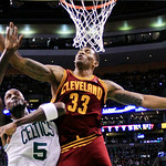 Boston Celtics forward Kevin Garnett (5) and Cleveland Cavaliers forward Alonzo Gee (33) battle under the basket during the second quarter of an NBA basketball game in Boston, Wednesday, Dec …