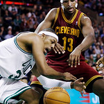 Boston Celtics forward Paul Pierce (34) battles for a loose ball against Cleveland Cavaliers forward Tristan Thompson (13) during the second half of an NBA basketball game in Boston, Wednesd …