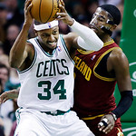 Boston Celtics forward Paul Pierce (34) makes a move against Cleveland Cavaliers point guard Kyrie Irving (2) during the second half of an NBA basketball game in Boston, Wednesday, Dec. 19, …