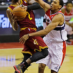 Cleveland Cavaliers guard Kyrie Irving shoots as he is defended by Washington Wizards guard Garrett Temple in the second half of an NBA basketball game, Wednesday, Dec. 26, 2012, in Washingt …