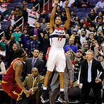 Washington Wizards guard Garrett Temple shoots, and misses, with Cleveland Cavaliers guard Kyrie Irving nearby late in the second half of an NBA basketball game, Wednesday, Dec. 26, 2012, in …