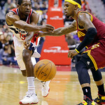 Washington Wizards guard Jordan Crawford, left, passes as he guarded by Cleveland Cavaliers guard Daniel Gibson in the second half of an NBA basketball game, Wednesday, Dec. 26, 2012, in Was …