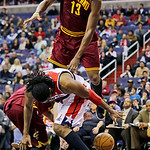 Cleveland Cavaliers forward Tristan Thompson (13) jumps and falls over Washington Wizards center Nene, of Brazil, in the second half of an NBA basketball game, Wednesday, Dec. 26, 2012, in W …