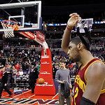 Cleveland Cavaliers guard Kyrie Irving removes his protective mask after an NBA basketball game against the Washington Wizards, Wednesday, Dec. 26, 2012 in Washington. Irving had 26 points i …