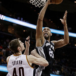 San Antonio Spurs' Tim Duncan (21) shoots over Cleveland Cavaliers' Tyler Zeller (40) during the fourth quarter of an NBA basketball game Wednesday, Feb. 13, 2013, in Cleveland. San Antonio  …