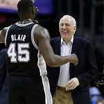 San Antonio Spurs coach Gregg Popovich high-fives DeJuan Blair during the first quarter of an NBA basketball game Wednesday, Feb. 13, 2013, in Cleveland. San Antonio won 96-95. (AP Photo/Ton …