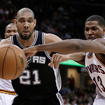 San Antonio Spurs' Tim Duncan (21) and Cleveland Cavaliers' Tristan Thompson (13) watch a loose ball during the first quarter of an NBA basketball game Wednesday, Feb. 13, 2013, in Cleveland …