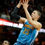 New Orleans Hornets' Austin Rivers (25) shoots against the Cleveland Cavaliers during the first quarter of an NBA basketball game Wednesday, Feb. 20, 2013, in Cleveland. (AP Photo/Mark Dunca …