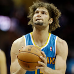 New Orleans Hornets' Robin Lopez shoots a fre throw against the Cleveland Cavaliers in an NBA basketball game Wednesday, Feb. 20, 2013, in Cleveland. (AP Photo/Mark Duncan)