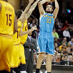 New Orleans Hornets' Ryan Anderson (33) shoots against the Cleveland Cavaliers in an NBA basketball game Wednesday, Feb. 20, 2013, in Cleveland. (AP Photo/Mark Duncan)
