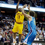 Cleveland Cavaliers' Tristan Thompson (13) shoots against New Orleans Hornets' Robin Lopez in an NBA basketball game Wednesday, Feb. 20, 2013, in Cleveland. (AP Photo/Mark Duncan)