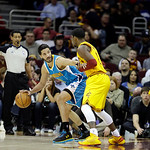 New Orleans Hornets' Greivis Vasquez, from Venezuela, center, is defended by Cleveland Cavaliers' Kyrie Irving in an NBA basketball game Wednesday, Feb. 20, 2013, in Cleveland. (AP Photo/Mar …