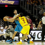 Cleveland Cavaliers' Kyrie Irving (2) defends New Orleans Hornets' Greivis Vasquez, from Venezuela, in an NBA basketball game Wednesday, Feb. 20, 2013, in Cleveland. (AP Photo/Mark Duncan)