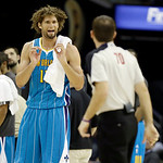 New Orleans Hornets' Robin Lopez argues a call with referee Brent Barnaky (70) during an NBA basketball game against the Cleveland Cavaliers Wednesday, Feb. 20, 2013, in Cleveland. (AP Photo …