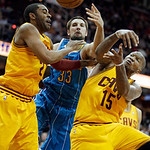 New Orleans Hornets' Ryan Anderson (33) reaches for a rebound between Cleveland Cavaliers' Wayne Ellington and Marreese Speights (15) during the fourth quarter of an NBA basketball game Wedn …