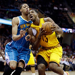 Cleveland Cavaliers' Tristan Thompson (13) drives on New Orleans Hornets' Anthony Davis in an NBA basketball game Wednesday, Feb. 20, 2013, in Cleveland. (AP Photo/Mark Duncan)