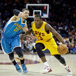 Cleveland Cavaliers' Dion Waiters (3) drives on New Orleans Hornets' Austin Rivers (25) in an NBA basketball game Wednesday, Feb. 20, 2013, in Cleveland. (AP Photo/Mark Duncan)