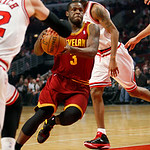 Cleveland Cavaliers' Dion Waiters (3) drives the lane in the first half of their NBA basketball game against the Chicago Bulls, Tuesday, Feb. 26, 2013, in Chicago. The Cavaliers won 101-98.  …