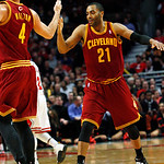 Cleveland Cavaliers' Wayne Ellington (21) is congratulated by Luke Walton (4) after hitting a shot against the Chicago Bulls at the end of the third quarter of their NBA basketball game, Tue …