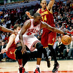 Chicago Bulls' Luol Deng keeps the ball inbounds despite pressure from Cleveland Cavaliers' Shaun Livingston (14) in the fourth quarter of their NBA basketball game, Tuesday, Feb. 26, 2013,  …
