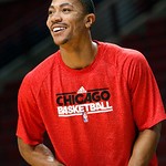 Chicago Bulls' Derrick Rose smiles while shooting before an NBA basketball game between the Bulls and the Cleveland Cavaliers, Tuesday, Feb. 26, 2013, in Chicago. Rose remains out while reco …