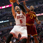 Chicago Bulls' Carlos Boozer (5) grabs a rebound from Cleveland Cavaliers' Tristan Thompson (13) during the first quarter of their NBA basketball game, Tuesday, Feb. 26, 2013, in Chicago. (A …