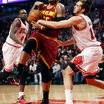 Chicago Bulls' Joakim Noah (13) slaps ball from the hands of Cleveland Cavaliers' Marreese Speights during the second quarter of an NBA basketball game, Tuesday, Feb. 26, 2013, in Chicago.(A …