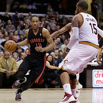 Toronto Raptors' DeMar DeRozan (10) drives on Cleveland Cavaliers' Marreese Speights (15) during the fourth quarter of an NBA basketball game Wednesday, Feb. 27, 2013, in Cleveland. The Cava …