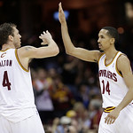 Cleveland Cavaliers' Shaun Livingston (14) high-fives Luke Walton during the fourth quarter of an NBA basketball game against the Toronto Raptors on Wednesday, Feb. 27, 2013, in Cleveland. T …